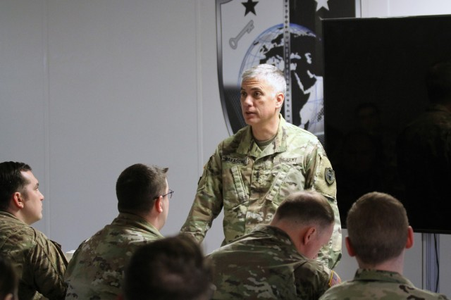 "FORT GEORGE G. MEADE, Md. -- Gen. Paul Nakasone, commander, U.S. Cyber Command and director, National Security Agency/chief, Central Security Service, talks with the outgoing ARNG Soldiers assigned to Task Force Echo II, at the Brigade annex on March 11. ""We are only as good as all the components-- Active, Reserve, and National Guard- and that is important to us,"" said Nakasone. ""On behalf of all of us at the United States Cyber Command and U.S. Army Cyber, which I had the pleasure of commanding before, and the Department of the Army, 'well done, well done'."""