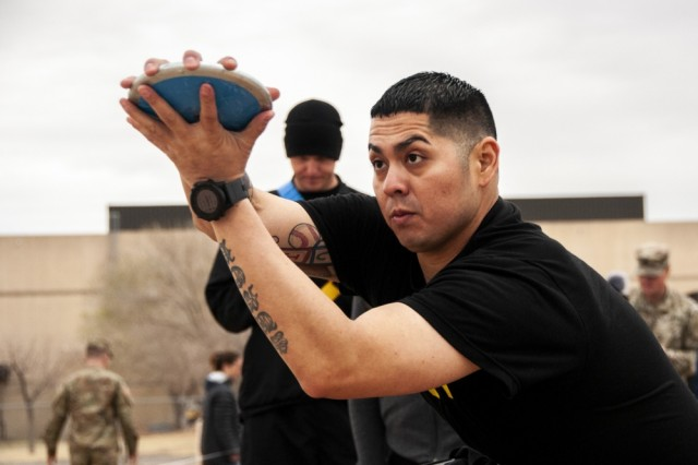 Sgt. Christopher Campos prepares for a discus throw during the field competition at the 2019 Army Trials, at Fort Bliss, Texas, March 11. Army Trials is an adaptive-sports competition taking place from March 5 - 16 with nearly 100 wounded, ill and injured active-duty Soldiers and veterans competing in 14 different adaptive sports for the opportunity to represent Team Army at the 2019 Department of Defense Warrior Games in Tampa, Fla.