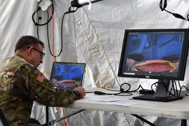 Col. (Dr.) Tyler Harris, an orthopedic surgeon at Womack Army Medical Center, observes as a student in the battlefield emergent skills triad training performs one of the medical tasks he learned at Fort Bragg, N.C., Feb. 7, 2019. The student wore augmented reality glasses that allowed Harris to observe their actions from the student's point-of-view. (U.S. Army photo by Eve Meinhardt, FORSCOM PAO)