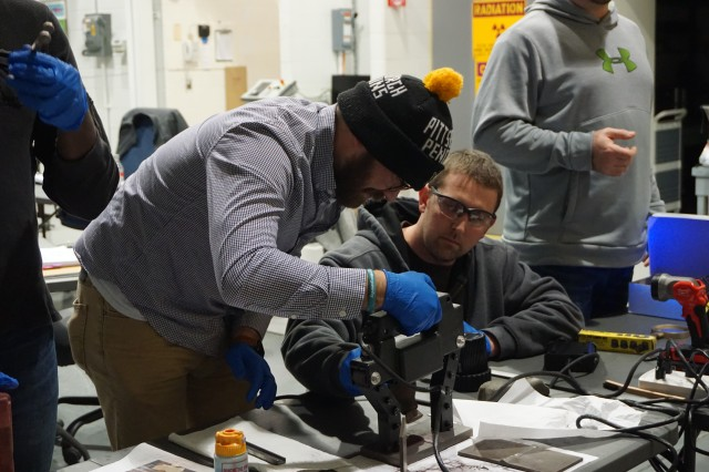 NDT technicians gain practical experience with magnetic particle testing, a non-destructive testing method, to determine if cracks, voids, or other issues exist with a weld during the hands-on portion of the NDT training conducted recently at Letterkenny Munitions Center.