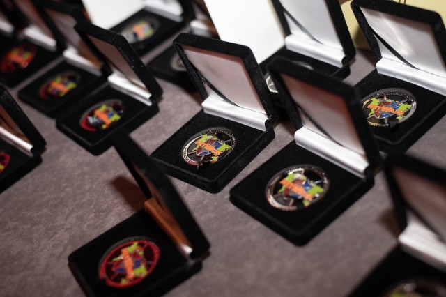 Award coins are displayed during the 2018 SANS Netwars Tournament of Champions in December 2018. NetWars is a computer and network security challenge designed to test a participant's experience and skills.