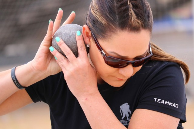 Retired Army Spc. Michelle Sanchez prepares to throw the shot put at the field events March 11, during the 2019 Army Trials. The 2019 Army Trials, hosted at Fort Bliss, is an adaptive sports competition from March 5-16 with over 100 wounded, ill and injured active-duty Soldiers and veterans competing in 14 different sports for the opportunity to represent Team Army at the 2019 Department of Defense Warrior Games in Tampa, Fla.