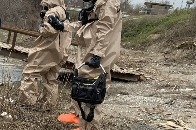 Two members of the 61st Civil Support Team, 87th Troop Command, Arkansas National Guard, don HAZMAT suits and search for chemical spills during a training exercise in West Memphis, Arkansas. The unit was involved in a New Madrid earthquake response exercise alongside several civilian emergency response agencies.