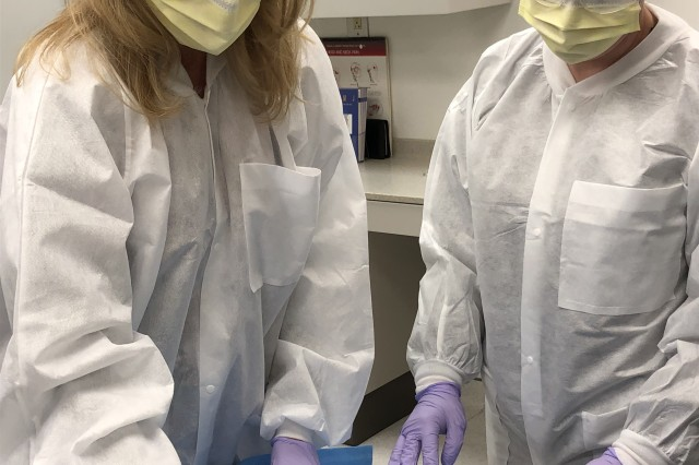 American Red Cross Dental Assistant Program student Becky Aiton, left, and former student and current DENTAC employee, Tasheena Miller, demonstrate the course-taught setup for an oral procedure.