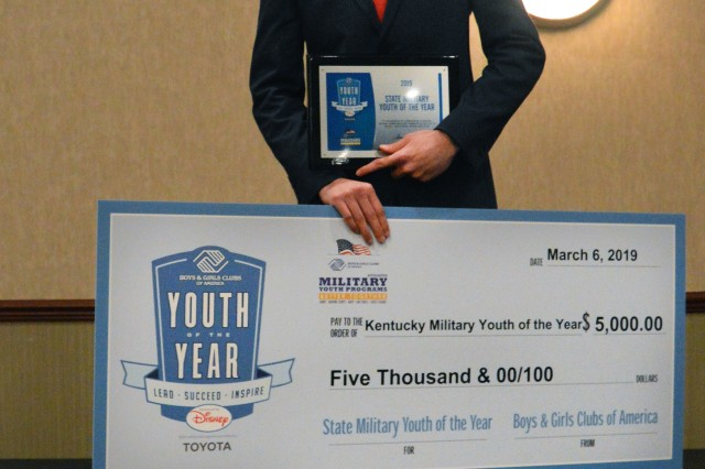Lauro Melendez holds up a check and certificate he earned for winning the 2019 Boys & Girls Clubs of America Kentucky State Military Youth of the Year competition March 6, 2019.
