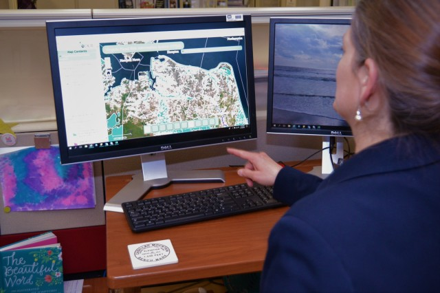Michelle Hamor, U.S. Army Corps of Engineers Norfolk District's Floodplain Management Services Section chief, points to flood-prone areas of on a map at Fort Norfolk, Virginia, March 13, 2019. The Norfolk District, along with state, federal and other agencies are attempting to keep Virginians informed in preparation for the upcoming hurricane season.