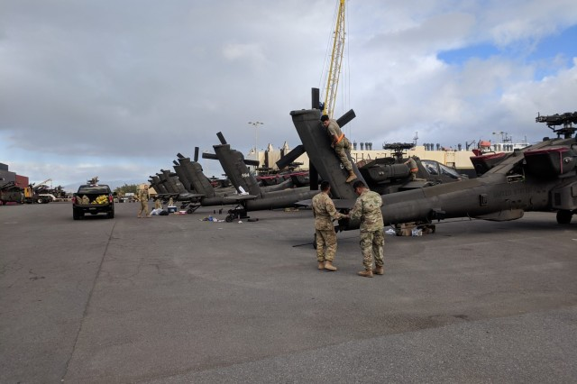 25th CAB Soldiers prepare helicopters for onward movement after offloading them at Honolulu Harbor on March 12.