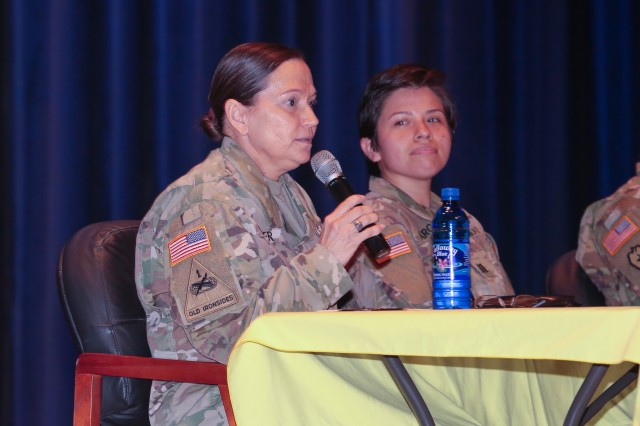 Command Sgt. Maj. Rebecca Booker, the Martin Army Hospital command sergeant major talks with audience members during a panel discussion. The 199th Infantry Brigade and the Maneuver Center of Excellence hosted a panel discussion on the changing role of women in the military March 15 in Marshall Auditorium at the MCoE Headquarters building.