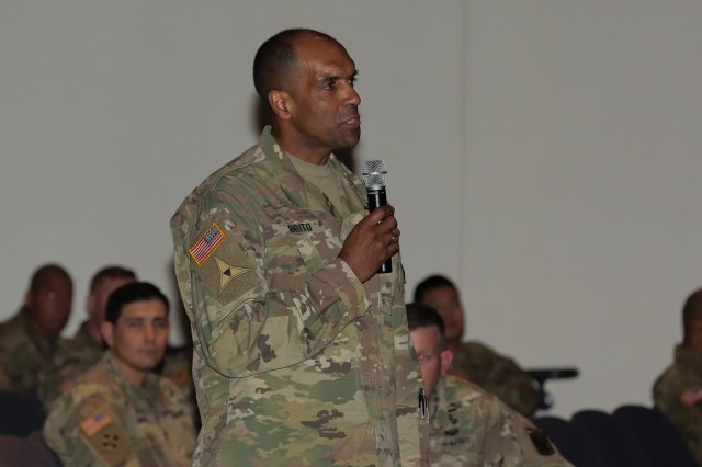 Maj. Gen. Gary M. Brito, commanding general of the Maneuver Center of Excellence and Fort Benning, asks a question during a panel discussion. The 199th Infantry Brigade and the Maneuver Center of Excellence hosted a panel discussion on the changing role of women in the military March 15 in Marshall Auditorium at the MCoE Headquarters building.
