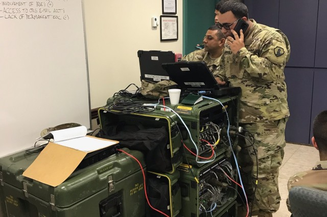 U.S. Army Reserve-Puerto Rico Soldiers from C Co 35th Expeditionary Signal Battalion, configure the Command Post Nodes, during the Vigilant Guard exercise, providing voice and date to users, to include the Commercial Coalition Equipment, which allowed the unit to provide commercial phone and internet services to the users, something that was critical during the emergency created by Hurricane Maria.