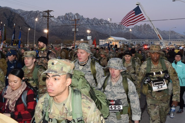 Marchers leave the starting gate at the 2019 Bataan Memorial Death March at White Sands Missile Range, N.M.