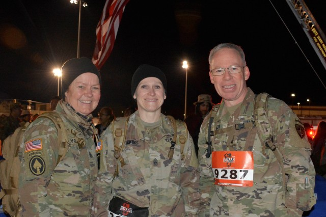 Command Sgt. Majors Sheryl Lyon (left) and Melissa Judkins join WSMR Commander Brig. Gen. Greg Brady before getting started on the 2019 Bataan Memorial Death March at White Sands Missile Range, N.M.