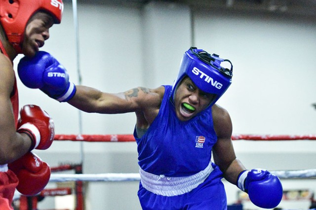 Staff Sgt. Naomi Graham throws a right to the chin of Briana Che during a USA nationals bout the first week of December in Salt Lake City, Utah. Graham rose through the ranks of USA Boxing after picking up the sport five years ago. She currently ranks No.3 in the world in the women's middleweight division.