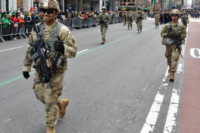 New York Army National Guard Soldiers in battle dress join the rest of the 1st Battalion, 69th Infantry, lead the battalion during the New York City St. Patrick's Day Parade on March 16, 2019. The 1st Battalion, 69th Infantry traditionally leads the world's largest St. Patrick's Day Parade. Soldiers of the 1st Battalion 69th Infantry and the 42nd Infantry Division Band led the parade up 5th Avenue.