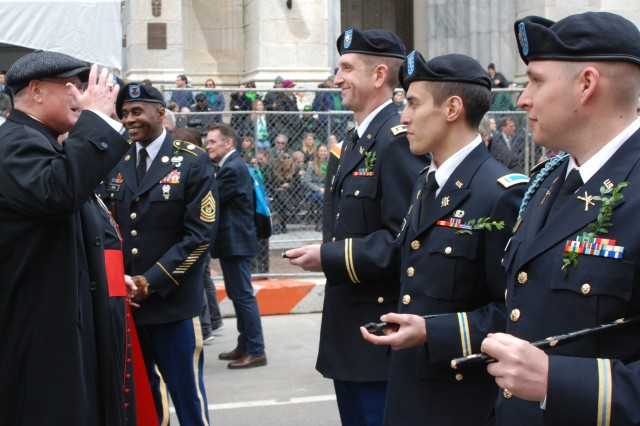 Cardinal Timothy Dolan, the Archbishop of New York, greats officers of the 1st Battalion, 69th Infantry on March 16, 2019, as the battalion prepares to lead the New York City St. Patrick's Day Parade. The Soldiers of the 1st Battalion 69th Infantry and the 42nd Division Band led the St. Patricks Day Parade up 5th Avenue.