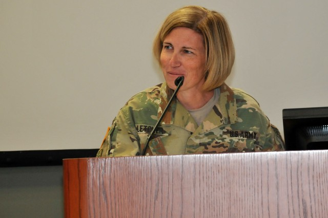 Brig. Gen. Michelle M.T. Letcher, commander, Joint Munitions Command, provides remarks to Command Sgt. Maj. Morrison's family and distinguished guests during the Assumption of Responsibility Ceremony, March 18.