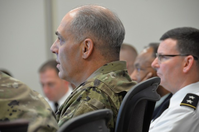 Gen. Gus Perna, Army Materiel Command's commander, and Maj. Gen. Jeff Drushal, Security Assistance Command's commander, listen to updates from USASAC personnel during Perna's quarterly visit March 15.