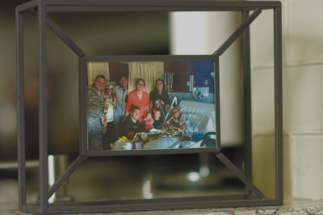 Alexis Piper keeps a framed photograph as a reminder of her time at Brooke Army Medical Center and the loving support of family, friends and staff members during her long recovery. Piper has sickle cell anemia is an inherited form of anemia, in which there aren't enough healthy red blood cells to carry adequate oxygen throughout the body.