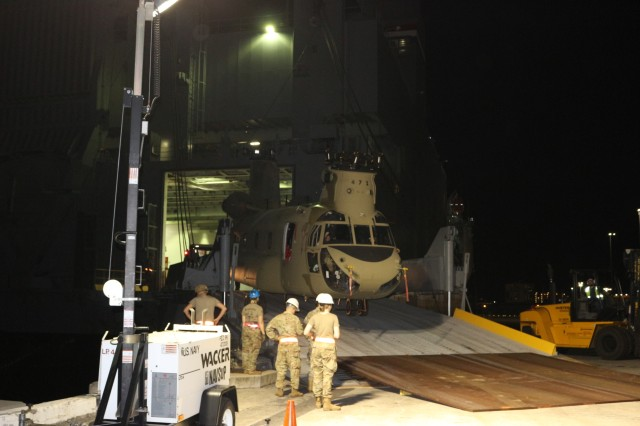 Soldiers offload helicopters from the Cape Orlando during nighttime port operations at Pearl Harbor on March 14.