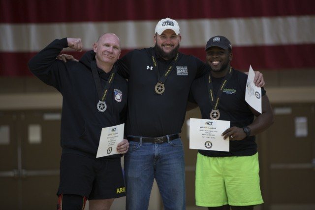 Sgt. 1st Class Joseph Fontenot, left, Staff Sgt. Ross Alewine, center, and Sgt. Cory Ivins, right, receive medals during the 2019 Army Trials powerlifting awards ceremony, Mar. 9. The 2019 Army Trials at Fort Bliss is an adaptive sports competition from 5-16 March with over 100 wounded, ill and injured active-duty Soldiers and veterans competing in 14 different sports for the opportunity to represent Team Army at the 2019 Department of Defense Warrior Games in Tampa, Fla.