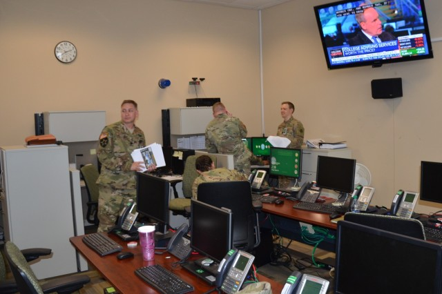 Soldiers man their battle stations in the 597th Transportation Brigade Communications Operations Integration Center at Fort Eustis, Virginia, March 19, 2019.