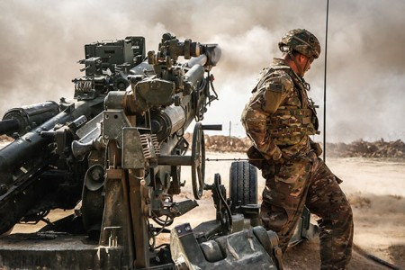 A 101st Airborne Division Soldier pulls the lanyard on an M777A2 howitzer during a fire mission in Southwest Asia, Jan. 26, 2019. The 101st Airborne Division deployed in support of Operation Inherent Resolve, working by, with and through the ISF and Coalition partners to defeat ISIS in areas of Iraq and Syria.