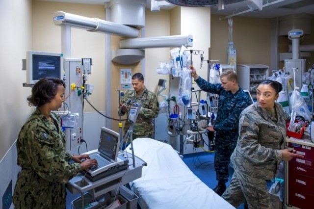 Army Medicine's 2018 quality and safety performance should make its hospitals attractive assets for the DHA as the transition of service-based medicine to DoD medicine continues to be implemented.  Here, staff at the Fort Belvoir Community Hospital prepare a room for a patient. The tri-service team at FBCH provides excellence in safety and quality to those entrusted to their care.