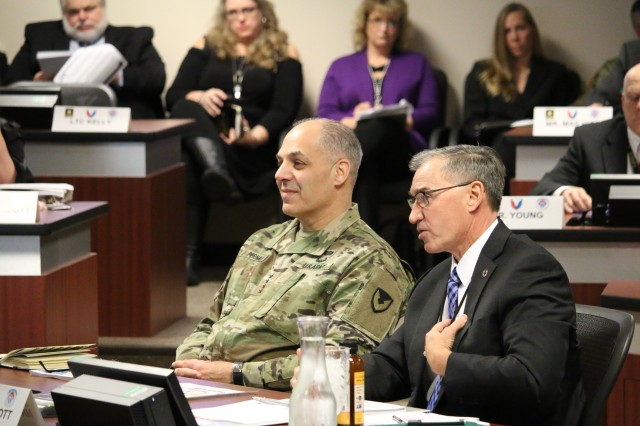Aviation and Missile Command Executive Director Bill Marriott explains his command's progress in seven strategic areas to Army Materiel Command's Commander Gen. Gus Perna as they review presentation charts during a March 12, 2019 quarterly update at AMCOM headquarters, Redstone Arsenal, Ala.