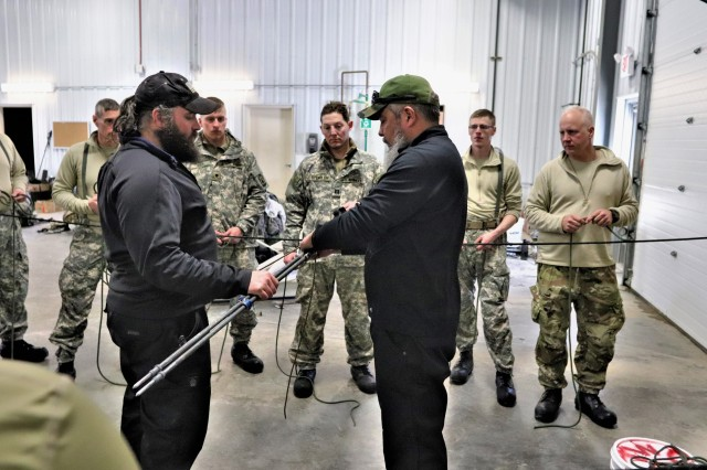 Students in Cold-Weather Operations Course (CWOC) Class 19-04 learn knot-tying skills from instructors Hunter Heard and Manny Ortiz on Feb. 8, 2019, at Fort McCoy, Wis. CWOC students are trained on a variety of cold-weather subjects, including snowshoe training and skiing as well as how to use ahkio sleds and other gear. Training also focuses on terrain and weather analysis, risk management, cold-weather clothing, developing winter fighting positions in the field, camouflage and concealment, and numerous other areas that are important to know in order to survive and operate in a cold-weather environment. The training is coordinated through the Directorate of Plans, Training, Mobilization and Security at Fort McCoy. (U.S. Army Photo by Scott T. Sturkol, Public Affairs Office, Fort McCoy, Wis.)