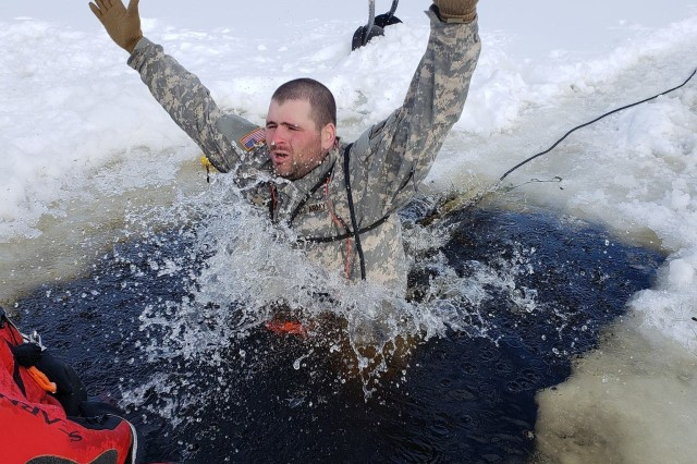 A student in Cold-Weather Operations Course (CWOC) Class 19-04 participates in cold-water immersion training at Big Sandy Lake on Feb. 18, 2019, on South Post at Fort McCoy, Wis. CWOC students are trained on a variety of cold-weather subjects, including snowshoe training and skiing as well as how to use ahkio sleds and other gear. Training also focuses on terrain and weather analysis, risk management, cold-weather clothing, developing winter fighting positions in the field, camouflage and concealment, and numerous other areas that are important to know in order to survive and operate in a cold-weather environment. The training is coordinated through the Directorate of Plans, Training, Mobilization and Security at Fort McCoy. (Photo by Joe Ernst, Fort McCoy, Wis.)