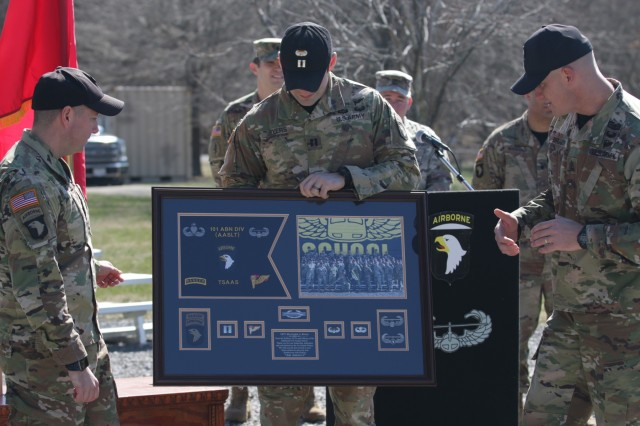 First Sergeant Benjamin Brady, senior enlisted advisor of The Sabalauski Air Assault School presents a gift highlighting career accomplishments to outgoing commander of TSAAS Captain Matthew Rivas' prior to his Change of Command Ceremony, Wednesday March 6, 2019 on Fort Campbell, Ky. Rivas' military education includes: Infantry Officer Basic Course, Maneuver Captain's Career Course, Air Assault School, Airborne School, Pathfinder Course, and Ranger School.