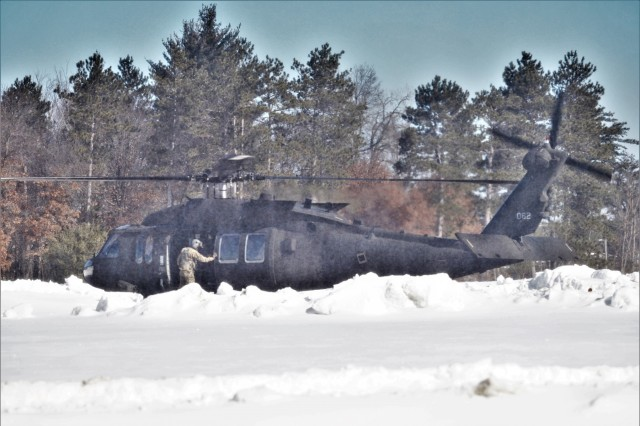 An aircrew with the 1st Battalion, 147th Aviation Regiment of the Wisconsin National Guard at Madison operate a UH-60 Black Hawk helicopter at the headquarters helo pad March 11, 2019, at Fort McCoy, Wis. Members of the unit regularly complete training operations at Fort McCoy and the unit also supports numerous training events at the installation each year. According to the Army fact sheet for the Black Hawk, its mission is to provide air assault, general support, aeromedical evacuation, command and control, and special operations support to combat, stability, and support operations. The UH-60 also is the Army's utility tactical transport helicopter. The versatile helicopter has enhanced the overall mobility of the Army due to dramatic improvements in troop capacity and cargo lift capability over the years as well. (U.S. Army Photo by Scott T. Sturkol, Public Affairs Office, Fort McCoy, Wis.)