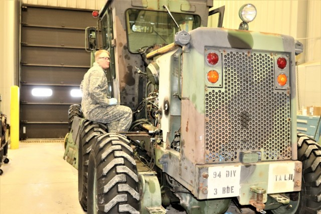 """A student in the 91L10 Construction Equipment Maintenance Repairer Course works on taking an engine out of a grader Feb. 20, 2019, during training at Fort McCoy's Regional Training Site-Maintenance facility at Fort McCoy, Wis. The completion of the course provided the students with certification in the Army's """"91-Lima"""" career field - construction equipment repairer. According to the Army, construction-equipment repairers are responsible for maintaining trucks, bulldozers, power shovels, and other heavy equipment needed for construction operations. (U.S. Army Photo by Scott T. Sturkol, Public Affairs Office, Fort McCoy, Wis.)"""