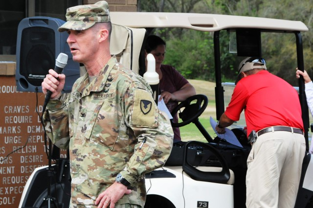 Col. Brian E. Walsh, Fort Rucker garrison commander, thanks the 100-plus golfers preparing to tee off at the 29th annual Army Emergency Relief Golf Tournament March 15 at Silver Wings Golf Course.