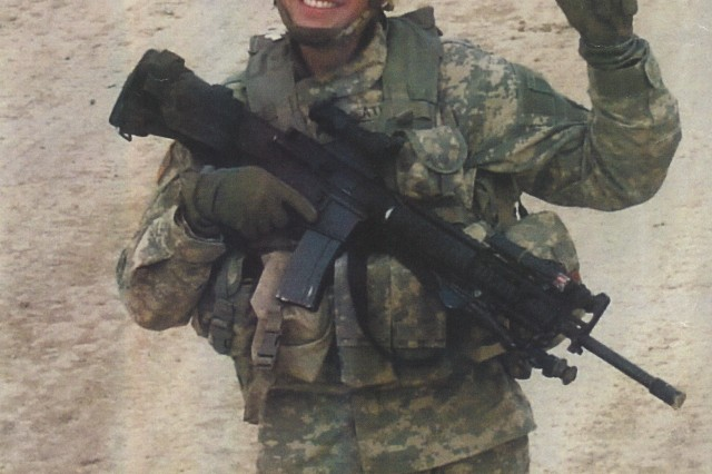 Sgt. Travis Atkins serves as a road guard in Iraq during 2007.