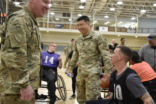 Command Sgt. Maj. Thomas Amason, senior enlisted advisor, Warrior Transition Battalion-Fort Carson, left, and Lt. Col. Jeff Han, commander, Warrior Transition Battalion-Fort Carson, center, congratulate Sgt. Tanner Kane, right, following the 2019 Army Trials wheelchair basketball competition, at Soto Physical Fitness Center, Fort Bliss, Texas, Mar. 15. Kane is an athlete assigned to the Fort Carson WTB. The 2019 Army Trials is an adaptive sports competition from Mar. 5-16 with over 100 wounded, ill and injured Soldiers and Veterans competing in 14 different sports for the opportunity to represent Team Army at the 2019 Department of Defense Warrior Games, coming this June to Tampa, Florida.