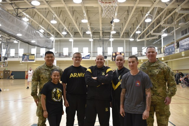(From left to right) Lt. Col. Jeff Han, commander, Warrior Transition Battalion-Fort Carson, with Army Trials athletes, Sgt. retired Maria (Jamie) Villarreal, Pfc. Joshua Berry, Spc. Trevor Miller, Sgt. 1st Class Angel Gonzalez, Sgt. Tanner Kane, and Command Sgt. Maj. Thomas Amason, senior enlisted advisor, WTB-Fort Carson, represent the Fort Carson WTB during the 2019 Army Trials, Fort Bliss, Texas, Mar. 15. The 2019 Army Trials is an adaptive sports competition from Mar. 5-16 with over 100 wounded, ill and injured Soldiers and Veterans competing in 14 different sports for the opportunity to represent Team Army at the 2019 Department of Defense Warrior Games, coming this June to Tampa, Florida.