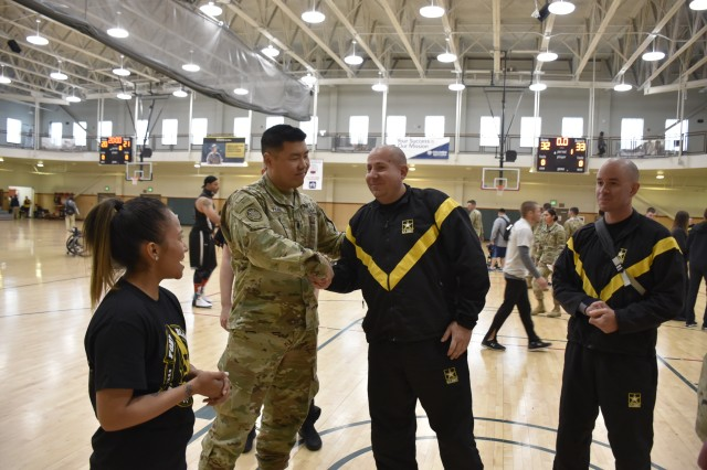 Lt. Col. Jeff Han, commander, Warrior Transition Battalion-Fort Carson, left-center, congratulates Spc. Trevor Miller, an athlete assigned to WTB-Fort Carson competing in the 2019 Army Trials, right-center, following the wheelchair basketball competition, at Fort Bliss, Texas, Mar. 15. The 2019 Army Trials is an adaptive sports competition from Mar. 5-16 with over 100 wounded, ill and injured Soldiers and Veterans competing in 14 different sports for the opportunity to represent Team Army at the 2019 Department of Defense Warrior Games, coming this June to Tampa, Florida.