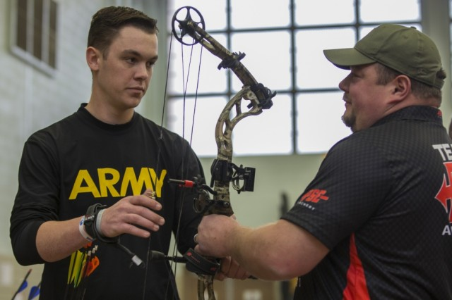 Archery coach Mitchell Irvin helps Spc. Christopher Mask adjust his bow sight during archery practice, March 8, at Milam Gymnasium, Fort Bliss, Texas. Mask is one of nearly 100 wounded, ill and injured active-duty Soldiers and veterans competing at the 2019 Army Trials in 14 different sports for the opportunity to represent Team Army at the 2019 Department of Defense Warrior Games in Tampa, Fla.
