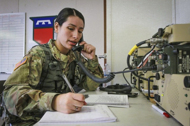 Army Reserve Spc. Heidi Quijada, a wheeled-vehicle mechanic and native of Chicago, Illinois, assigned to the 379th Chemical Company, 472nd Chemical Battalion, 209th Regional Support Group, 76th Operational Response Command, provides radio communications at the Tactical Operations Center at Fort McCoy, Wisconsin March 14.  More than 150 Army Reserve Soldiers from the 379th Chemical Company are spending nearly three-weeks at Fort McCoy conducting a variety of Chemical, Biological, Radiological and Nuclear (CBRN) training operations including chemical reconnaissance, decontamination, maneuver support, communications and transportation.  (Official U.S. Army Reserve photo by Sgt. 1st Class Brent C. Powell)