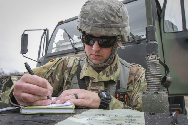 Army Reserve Sgt. Ryan Hetzler, a team leader and native of Rockledge, Florida, assigned to the 379th Chemical Company, 472nd Chemical Battalion, 209th Regional Support Group, 76th Operational Response Command, makes final mission notes before his unit leaves for a chemical reconnaissance and decontamination mission  at Fort McCoy, Wisconsin March 14.  More than 150 Army Reserve Soldiers from the 379th Chemical Company are spending nearly three-weeks at Fort McCoy conducting a variety of Chemical, Biological, Radiological and Nuclear (CBRN) training operations including chemical reconnaissance, decontamination, maneuver support, communications and transportation.  (Official U.S. Army Reserve photo by Sgt. 1st Class Brent C. Powell)