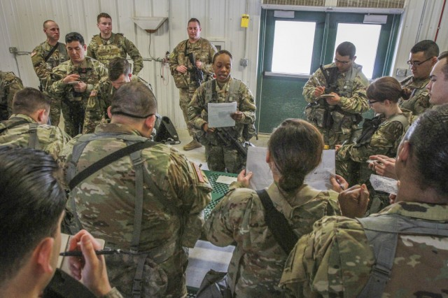 Army Reserve Soldier 1st Lt. Datisha Nono (center), platoon commander, 2nd Platoon, 379th Chemical Company, 472nd Chemical Battalion, 209th Regional Support Group, 76th Operational Response Command, gives a pre-mission briefing to members of her platoon along with the company commander and first sergeant at Fort McCoy, Wisconsin March 14.  More than 150 Army Reserve Soldiers from the 379th Chemical Company are spending nearly three-weeks at Fort McCoy conducting a variety of Chemical, Biological, Radiological and Nuclear (CBRN) training operations including chemical reconnaissance, decontamination, maneuver support, communications and transportation.  (Official U.S. Army Reserve photo by Sgt. 1st Class Brent C. Powell)