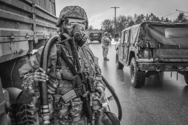 Army Reserve Spc. Axel Alvarado, a Chemical, Biological, Radiological and Nuclear  (CBRN) specialist and native of Springdale, Arkansas assigned to the 379th Chemical Company, 472nd Chemical Battalion, 209th Regional Support Group, 76th Operational Response Command waits to spray water on a vehicle during a chemical reconnaissance and decontamination mission at Fort McCoy, Wisconsin March 14.  More than 150 Army Reserve Soldiers from the 379th Chemical Company are spending nearly three-weeks at Fort McCoy conducting a variety of Chemical, Biological, Radiological and Nuclear (CBRN) training operations including chemical reconnaissance, decontamination, maneuver support, communications and transportation.  (Official U.S. Army Reserve photo by Sgt. 1st Class Brent C. Powell)