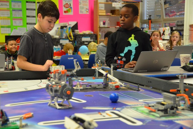 """Fifth graders, Gabriel H. and Gregory M., on team """"Beast aka Santa Claus"""" watch their robot perform a complex maneuver. They were one of six Smith Elementary School teams to participate in the First Lego League competition, March 18."""