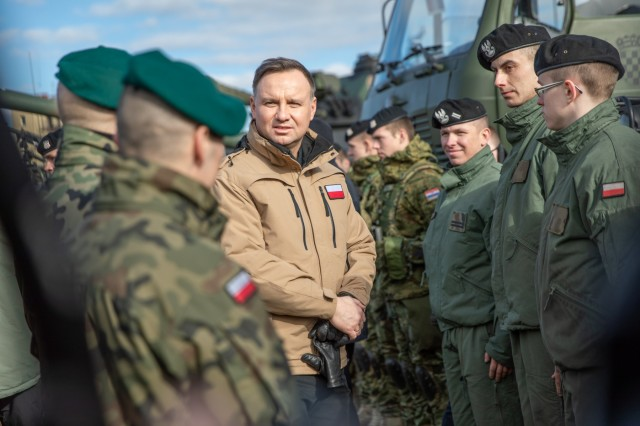 Poland's President Andrzej Duda addresses Soldiers assigned to Battle Group Poland (BGPol) during a visit he made to Bemowo Piskie Training Area, Poland, March 6. BGPol is a unique, multinational coalition of U.S., U.K., Croatian and Romanian Soldiers who serve with the Polish 15th Mechanized Brigade as a deterrence in support of NATO's Enhanced Forward Presence.