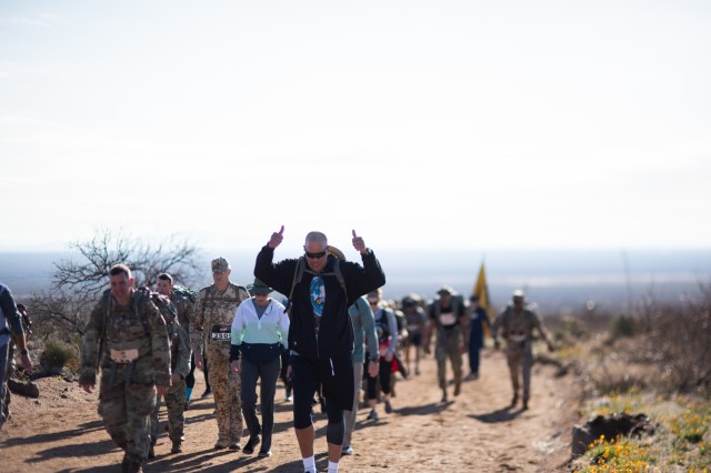 Maj. Gen. Michael Thompson, adjutant general for Oklahoma, marches alongside Oklahoma National Guard members from around the state, joining more than 8,600 people from around the world during the 30th annual Bataan Memorial Death March, Sunday. The March, established in 1989, honors the heroic service members who defended the Philippine Islands during World War II, sacrificing their freedom, health and, in many cases, their lives.