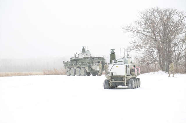 An NBCRV and UGV, outfitted with the new chemical detection sensor package, are positioned for the demonstration.