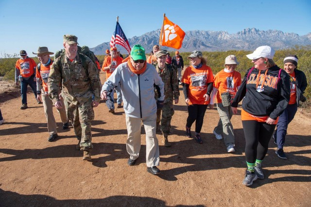 Ben Skardon makes his annual march to Mile Marker 8 with family and friends during the Bataan Memorial Death March, March 17. To his immediate left is his grandniece 1st Lt. Sally Myers who sang the national anthem at the opening ceremony.