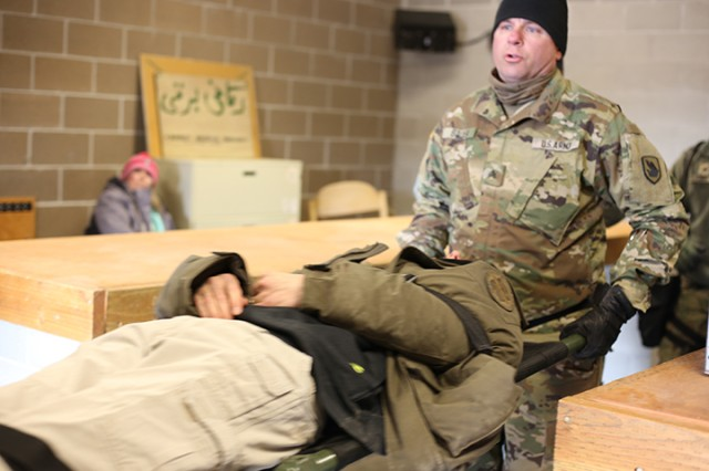 Members of the CBRNE assistance support element provide simulated first aide to role players during Idaho Response 19. CASE members provided only the amount of aid required to get the role player to the medical tent where they were treated for their simulated wounds. During an exercise extensive make-up known as moulage is used to create a realistic look.
