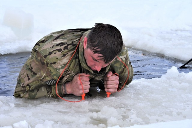 A student in the Cold-Weather Operations Course (CWOC) Class 19-05, which included many Soldiers from the 75th Ranger Regiment, participates in cold-water immersion training March 5, 2019, at Fort McCoy, Wis. CWOC students are trained on a variety of cold-weather subjects, including skiing and snowshoe training as well as how to use ahkio sleds and other gear. Training also focuses on terrain and weather analysis, risk management, cold-weather clothing, developing winter fighting positions in the field, camouflage and concealment, and numerous other areas that are important to know in order to survive and operate in a cold-weather environment. The training is coordinated through the Directorate of Plans, Training, Mobilization and Security at Fort McCoy.